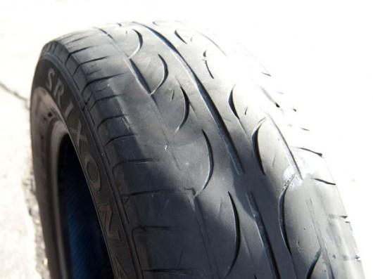 Определить неисправность по износу шины